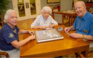 Residents playing a board game